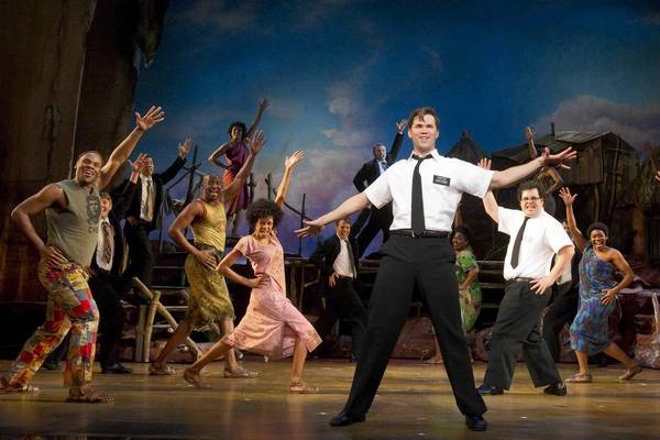 "Nikki M. James (left), Andrew Rannells, Josh Gad and ensemble in ""The Book of Mormon"" Eugene O'Neill Theatre."
