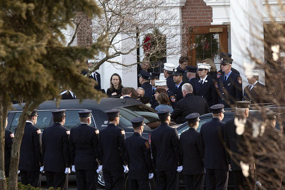 The family of Daniel Barden, 7, a victim of the shooting at Sandy Hook Elementary School, arrives at St. Rose of Lima Church for his funeral Wednesday in Newtown, Conn.