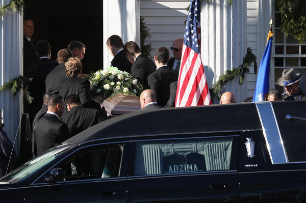 A casket carrying the body of slain teacher Victoria Soto arrives to the Lordship Community Church on Wednesday in Stratford, Conn. The first-grade teacher died while protecting her students during Friday's shooting at Sandy Hook Elementary School.