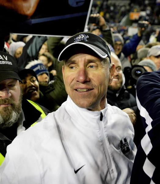 tah State Aggies head coach Gary Andersen celebrates in a sea of fan after the conclusion of the Famous Idaho Potato Bowl at Bronco Stadium. Utah State defeated Toledo 41-15. Mandatory Credit: Brian Losness-USA TODAY