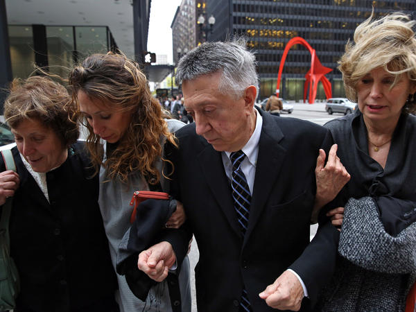 William Cellini leaves the Dirksen U.S. Courthouse on Oct. 4 after his sentencing for his conviction on charges of attempting to extort a contribution in 2004 for then-Gov. Rod Blagojevich's campaign from a Hollywood producer who wanted to keep his lucrative business with the state. He is accompanied by his wife, Julie, right, and daughter Claudia, second from left. Cellini was sentenced to one year in prison. Go here to read the story.