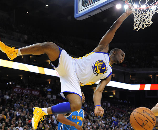 Golden State Warriors power forward Carl Landry dunks the ball against the New Orleans Hornets.