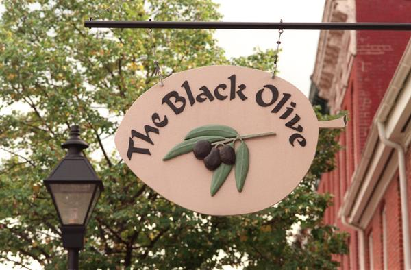 "The Black Olive is taking reservations for a five-course <a class=""taxInlineTagLink"" id=""EVFES000168"" title=""New Year's Day"" href=""/topic/arts-culture/holidays/new-years-day-EVFES000168.topic"">New Year's Eve</a> dinner. The entree options include loup de mer, lobster tail, crab cakes and petite filet mignon with portobello mushrooms. The cost is $80 per person.<br> <br> • Restaurant info.: <a href=""http://findlocal.baltimoresun.com/listings/black-olive-baltimore"">Black Olive</a>, 814 S. Bond St., <a class=""taxInlineTagLink"" id=""PLGEO100100603011100"" title=""Fells Point"" href=""/topic/us/maryland/baltimore-county/baltimore/fells-point-PLGEO100100603011100.topic"">Fells Point</a>, 410-276-7141, <a href=""http://www.theblackolive.com"" target=""new"">www.theblackolive.com</a>"