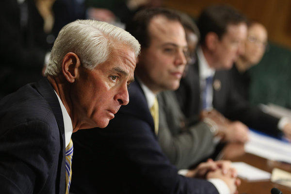 Former Florida Gov. Charlie Crist, left, testifies before the Senate Judiciary Committee hearing on voting regulations.
