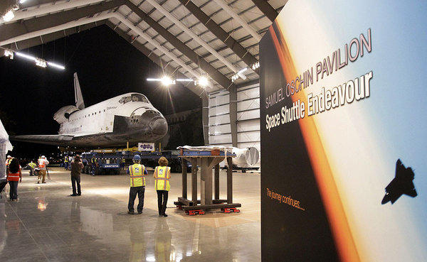 The decommissioned space shuttle Endeavour reaches its final home in Los Angeles in October. A committee of the National Research Council discussed the direction of NASA's human space flight program in Washington on Wednesday.