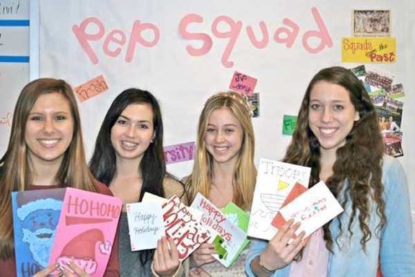 "La Cañada High School Pep Squad members, from left, Sofia Micalizio, Claudia Weinstein, Roxanne Sevigny and Kate Rappard, joined members of the La Cañada Junior Women's club in creating more than 500 personalized holiday cards for the American Red Cross program, ""Holiday Cards for Heroes."""