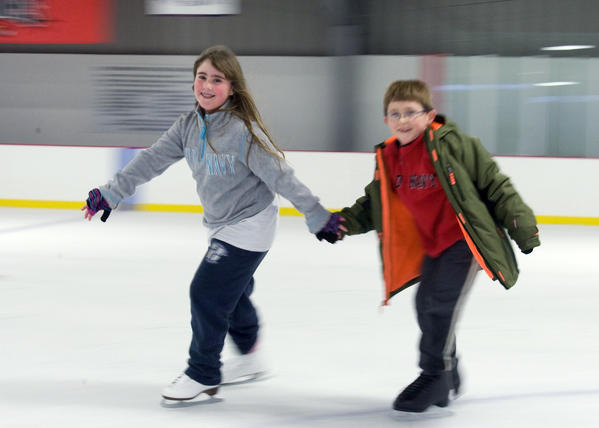 Tess Horn (left), 9, of Macungie skates with her friend Tyler Stuber, 8, of Pen Argyl at the Bethlehem Municipal Ice Rink on Tuesday afternoon.