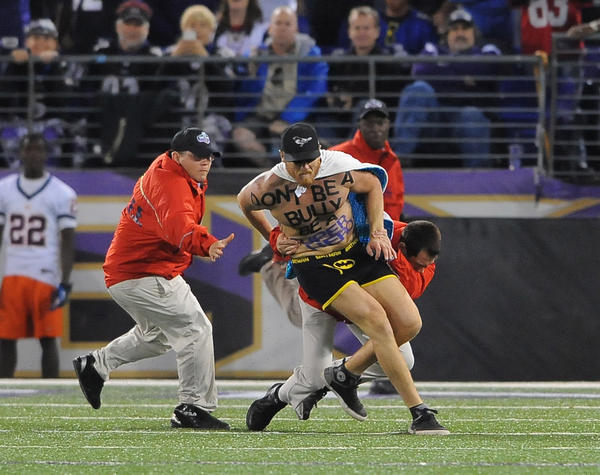 """Batman"" ran on the field in the 2nd quarter and was brought down by guards."