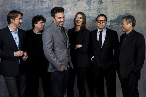 "Tom Hooper (""Les Miserables""), left, Sacha Gervasi (""Hitchcock""), Ben Affleck (""Argo""), Kathryn Bigelow (""Zero Dark Thirty""), David O. Russell (""Silver Linings Playbook"") and Ang Lee (""Life of Pi"") pose before joining the L.A. Times Directors Roundtable."