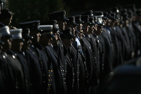 NEWTOWN, CT; 12/19/2012: An honor guard of firefighters from around the state stand at attention at the funeral of Daniel Barden, 7, who died in the mass school shooting Friday in Newtown. Two funeral masses were held back to back at St. Rose of Lima.