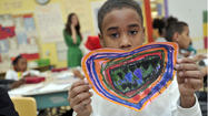 Baltimore students make paper hearts for Newtown families