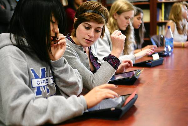Federal Trade Commission Chairman Jon Leibowitz said regulators were trying to keep pace with the growing use of mobile devices by those under age 13. Above, students test out the Apple iPad as a study tool in 2010 at Monte Vista Christian School in Watsonville, Calif.