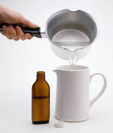 Person pouring glycerin solution in jug