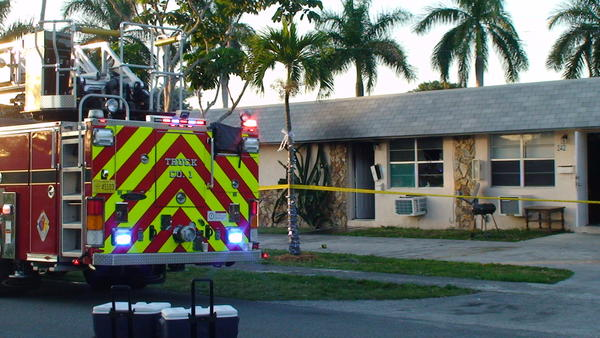 A woman was shot in the neck with a flare gun at 242 SW 11 Street, in Dania Beach, which set fire to the apartment.