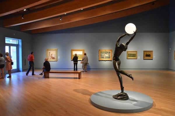 "<a href=""http://crystalbridges.org"">Crystal Bridges Museum of American Art</a>, Arkansas. Crystal Bridges, which opened in late 2011, is largely bankrolled by members of the Walton family of Wal-mart fame. So it's no surprise that the swooping, glass-walled museum building can be found in Bentonville, Ark., where Wal-mart is headquartered. The collection, which covers colonial to contemporary eras, is intriguing and growing fast. And just outside, you find heartland scenery, the Ozark mountains, small-town friendliness and a hub of global commerce. After putting up big-box stores around the world -- and being blamed for the decline of many a Main Street -- Wal-Mart and its founding family have relaunched their hometown's downtown. My story <a href=""/topic/services-shopping/la-tr-arkansas-20121014,0,7447088.story"">here</a>."
