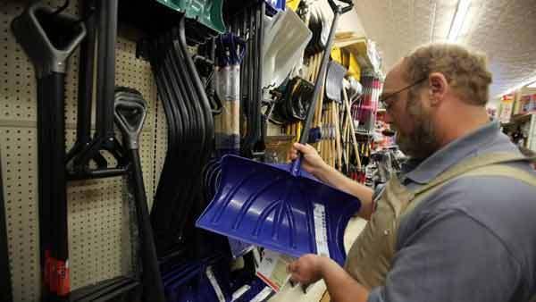 Sales clerk Bill Yekel checks shovels on display at the Village True Value hardware store in Western Springs.