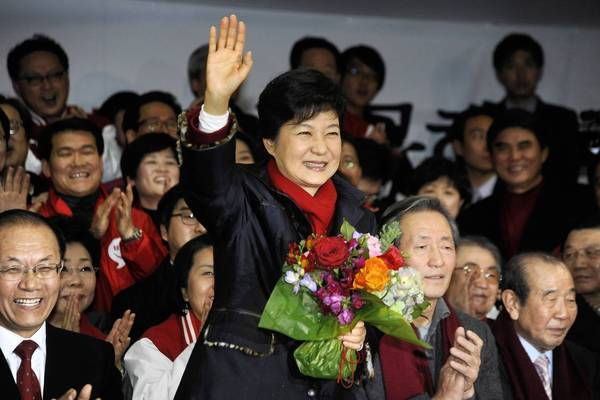 South Korean President-elect Park Geun-hye celebrates with members of her party in Seoul.