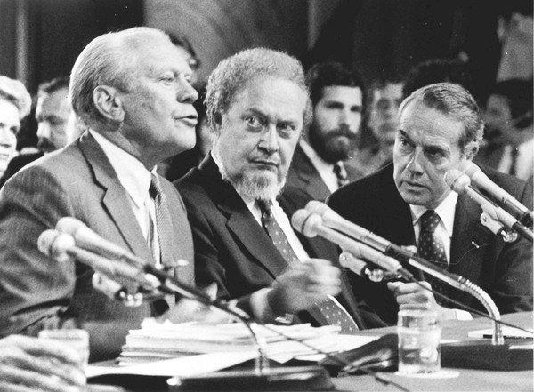 Former President Ford, left, introduces Supreme Court nominee Robert H. Bork, center, at a hearing of the Senate Judiciary Committee in Washington in September 1987. Republican Sen. Robert Dole of Kansas is at right.