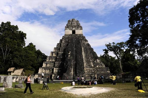 "Tourists are seen in front of the ""Gran Jaguar"" Mayan temple at the Tikal archaeological site in Peten departament, 560 kms north of Guatemala City, on December 19, 2012."