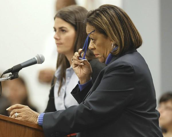 Chicago Public Schools employee Carly Bolger, left, and Chicago Public Schools CEO Barbara Byrd-Bennett answer questions from board member Andrea Zopp regarding future charter school locations at Wednesday's board meeting.