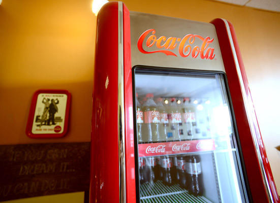 At the Old School Sandwich Company restaurant this is a unique Coca-Cola dispensing machine.