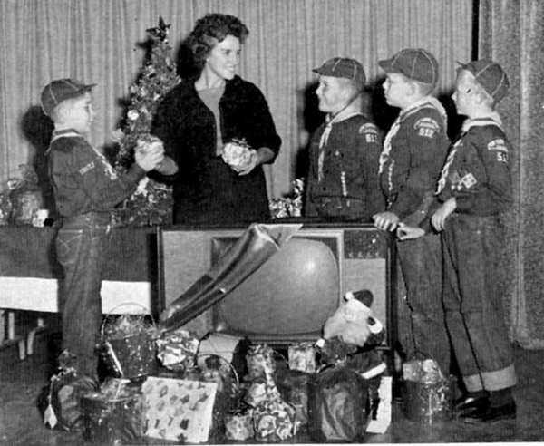 La Cañada Pack 512 Cub Scouts present handmade toys and a large television set to Marie Wahnschaffe of Olive View Sanitorium in December 1962 for the children's ward there. The Cubs are, from left, Ricky Snyder, Roland Wood, Leigh Zeitz and Jeff Schimmel.