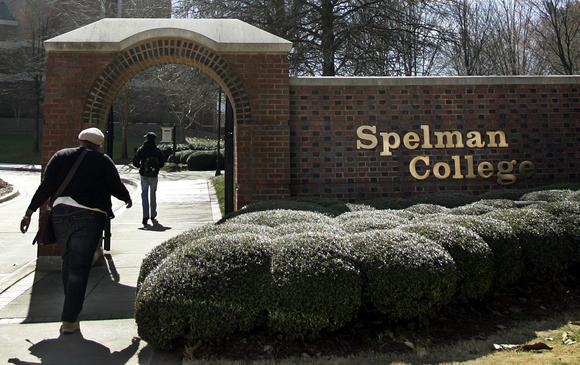 Students walk past the entrance to Spelman College in Atlanta, Georgia