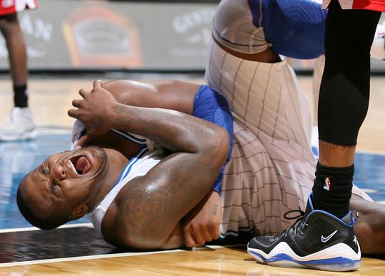 Orlando forward Glen Davis screams in agony as he falls during the Washington Wizards at Orlando Magic NBA game at the Amway Center on Wednesday, December 19, 2012. Orlando won the game 90-83.