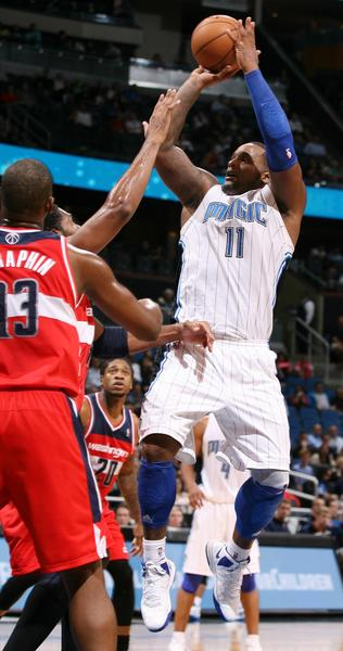 Orlando forward Glen Davis (11) shoots over Washington center Kevin Seraphin (13) during the Washington Wizards at Orlando Magic NBA game at the Amway Center on Wednesday, December 19, 2012. Orlando won the game 90-83.