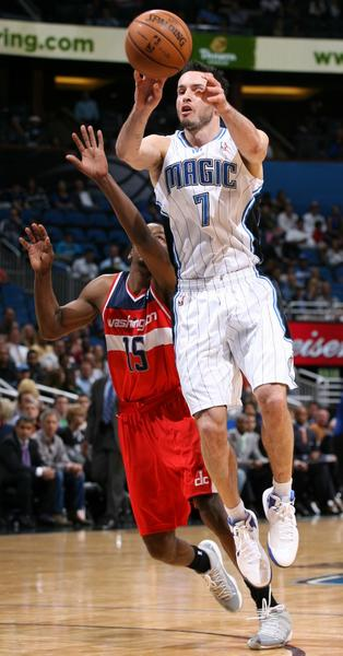 Orlando guard J.J. Redick (7) passes in front of Washington guard Jordan Crawford (15) during the Washington Wizards at Orlando Magic NBA game at the Amway Center on Wednesday, December 19, 2012. Orlando won the game 90-83.