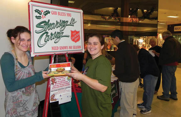 Stephanie Koons, left, of Chambersburg, Pa., and her baking buddy Amber Hauger, of Greencastle, Pa., used their culinary talents at the Cookie Contest at the Chambersburg Mall Wednesday to help raise money for the Salvation Army.