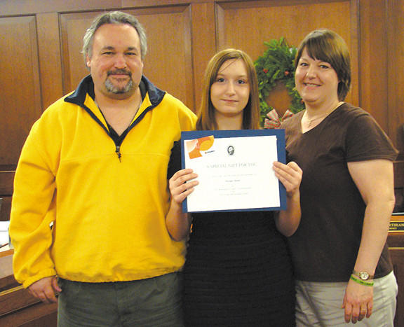 Morgan Meuse, center, an eighth-grader at Clear Spring Middle School, received the Youth Meritorious Award during the Nov. 27 meeting of the Washington County Board of Commissioners. Standing with Morgan are her parents, David and Michele Meuse.