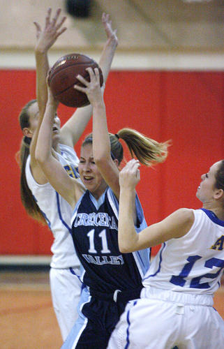 Crescenta Valley's Jacqueline Wilson is double teamed by the full-court press of Agoura's Natalie Bradley and Kim Jacobs in the first half of the Magnolia Park Optimist Girls Basketball Tournament at Burroughs High School in Burbank on Wednesday, December 19, 2012.