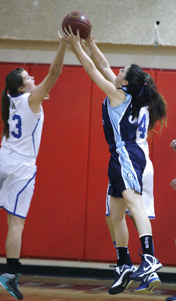 Crescenta Valley's Emily Beglarian grabs the rebound over Agoura's Jesse Thompson in the first half of the Magnolia Park Optimist Girls Basketball Tournament at Burroughs High School in Burbank on Wednesday, December 19, 2012.