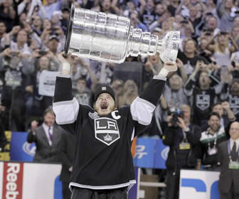 Kings center and captain Dustin Brown lets out a yell as he hoists the Stanley Cup overhead during his lap around the ice following a 6-1 victory over the New Jersey Devils in Game 6 in June at Staples Center. Los Angeles won its first NHL championship after 45 years.