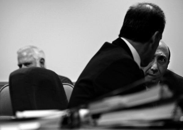 Albert Daher, right, talks with attorney Daniel R. Friedenthal at his hearing before the state Board of Pharmacy in November. Daher, owner of Jay Scott Drugs, denies any wrongdoing. (Liz O. Baylen / Los Angeles Times)
