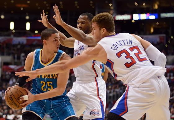 The New Orleans Hornets' Austin Rivers looks to pass around the defense of Willie Green and Blake Griffin.