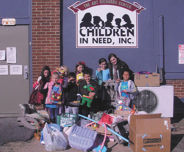 Children from King's Kids Child Care and Learning Center collected items for Children In Need. Front row, from left, Madison Vanassa, Griffin Moss, Jake Kochersberger and Amelia Robins. Back row, Reese Sitter, Hannah Stone, Megan Waldrop, Bryson Ostrum and Brittany Appleby.