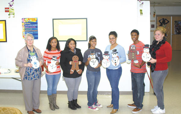 Mary Singing, left, from Contemporary School of the Arts and Gallery Inc. in Hagerstown, taught an art class Dec. 2 for members of the Hagerstown YMCA Achievers. The students included, from left, Alexus Rivas, Naomi Smith, Faith Franklin, Lauren Villa, Aaron McFarland and Katie Shields.