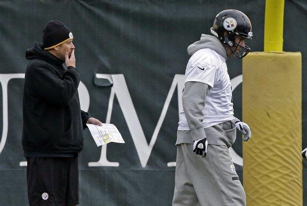 Pittsburgh Steelers offensive coordinator Todd Haley, left, and quarterback Benn Roethlisberger at practice Wednesday. Roethlisberger blamed his blunt comments after Sunday's loss to Dallas on frustration.
