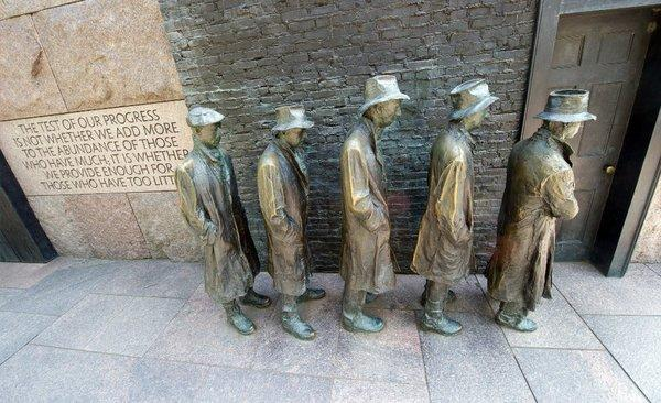 Statues depicting men standing in a unemployment line during the Great Depression at the Franklin D. Roosevelt Memorial in Washington.