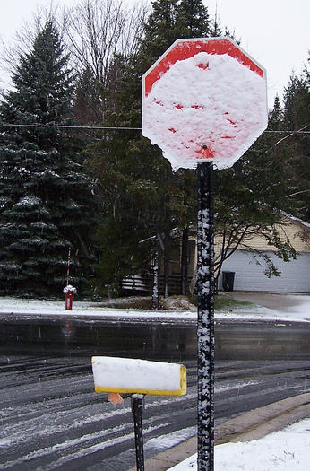 Snow stop sign near NCMC