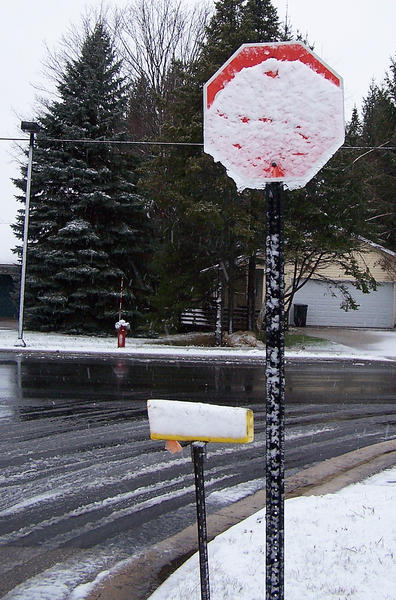A stop sign near the North Central Michigan College campus in Petoskey, looks familiar but states nothing thanks to early snow cover Thursday morning.