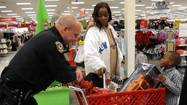 With clothes and My Little Pony toys in her shopping cart, 8-year-old Brianna Weaver was just about to head to the Target checkout line, when a police officer intervened.
