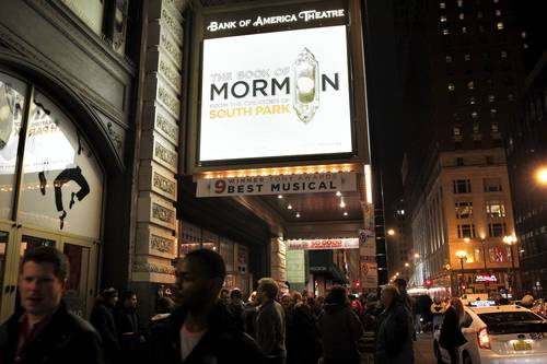 People leave the Bank of America Theatre after attending the opening night show of The Book of Mormon in Chicago on Wednesday, December 19, 2012.
