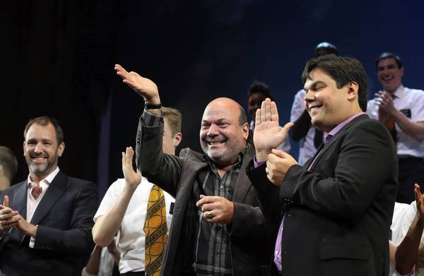 The Book of Mormon creative team members Casey Nicholaw, center,(choreographer, co-director) and Robert Lopez (book, music lyrics) (right), take a curtain call with cast members following the opening night show at Bank of America Theatre in Chicago on Wednesday, December 19, 2012.