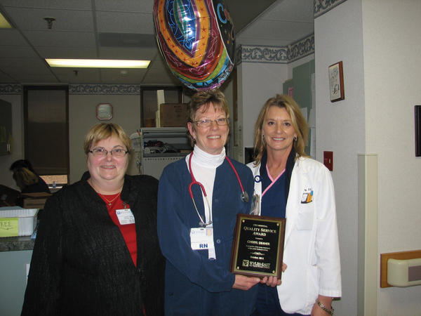 City Hospital's October Quality Service Award winner, Cheryl Deaner, center, is pictured receiving her award from Terry Reser, left, oncology nurse director, and Kim Shipley, nursing supervisor.