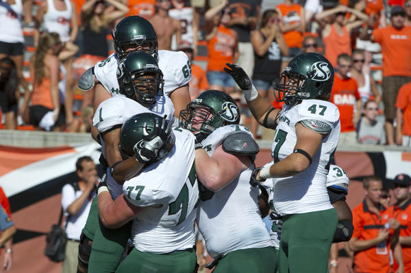 Members of the Sacramento State football team celebrate defeating the Oregon State Beavers in overtime in 2011.