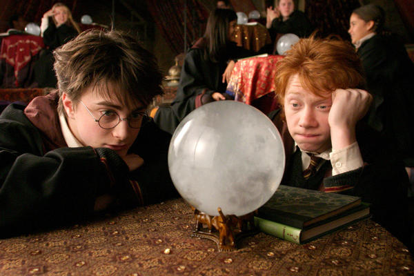 "Harry (Daniel Radcliffe) and Ron (Rupert Grint) sulk during Professor Trelawney's Divination class in ""Harry Potter and the Prisoner of Azkaban."""