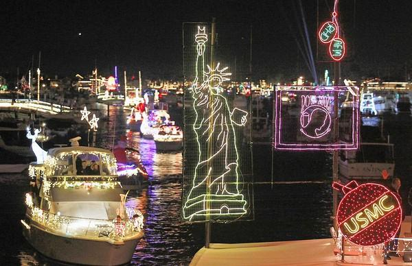 A vessel dedicated to America's veterans, which included a lighted Statue of Liberty, U-turns at the Balboa Island Bridge in the 104th annual Newport Beach Christmas Boat Parade on Wednesday.